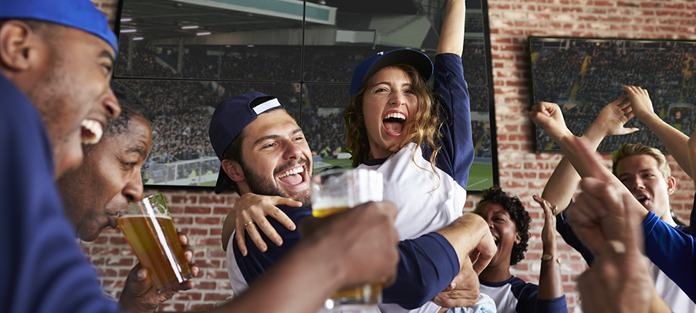 Fans enjoying baseball at a sports bar